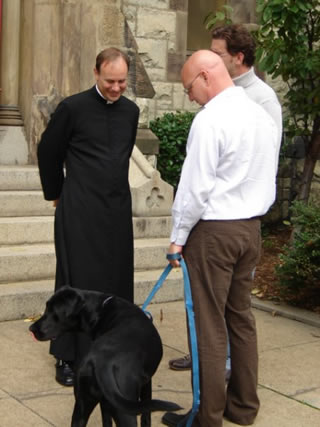 Rector, parishioners and their dog
